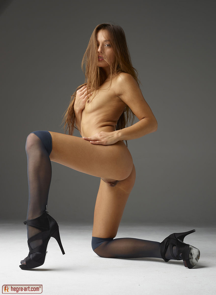 Variant does Sexy in high heels on knees for that