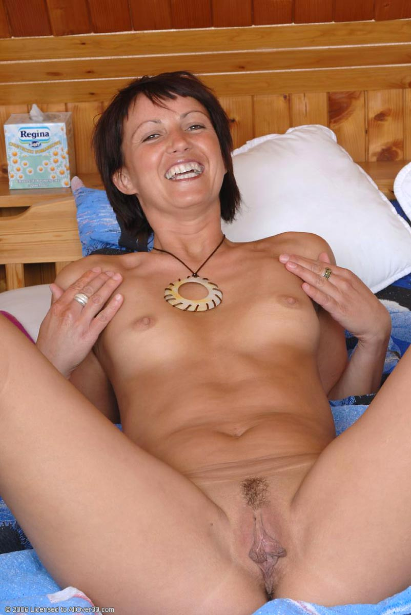 horny slim milf fucking a toy in her bed