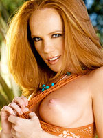 Seductive tall redhead fucking a sex toy outside from Twisty's