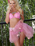 Petite blonde model posing in pink from Twisty's
