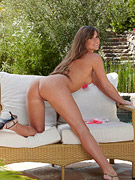 Hot natural bikini babe strips by the pool from Twisty's